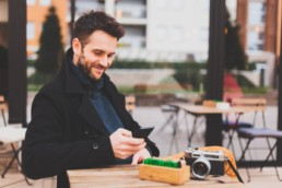 A case study of a happy customer - man sat outside on his phone