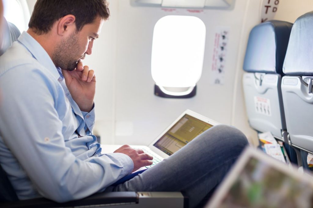 How a more emotional customer experience can transform loyalty - a man working during a flight